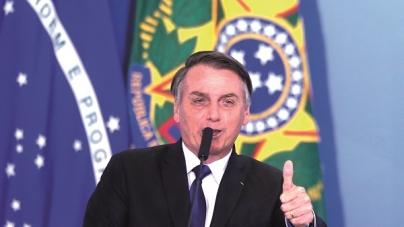 Bolsonaro assina decreto que facilita acesso a munição e transporte de armas